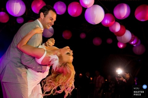 Houston Documentary Wedding Photographer | Image contains: reception, dance, bride, groom, pink lanterns
