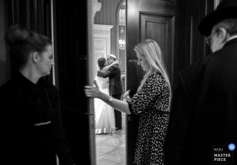 London Wedding Photographer | Image contains:  bride, groom, hug, venue, hall, vendor