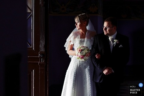 Poland Wedding Photographer | Image contains: bride, groom, color, indoors, door, flowers