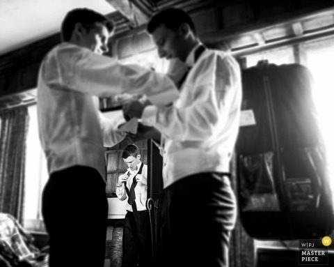 Bristol Documentary Wedding Photographer | Image contains: black and white, groom, groomsmen, getting ready, shirt, tie, pre-ceremony