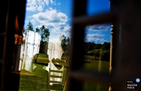 Raleigh Wedding Photography | Image contains: window, reflection, getting ready, color, outside, bride