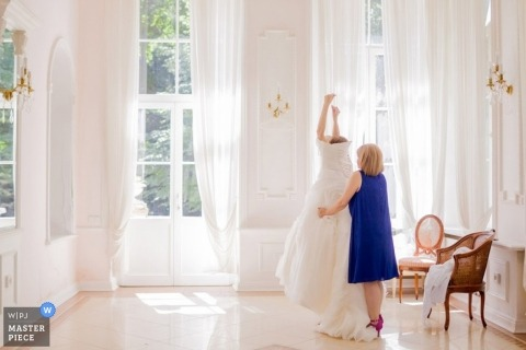 Hamburg Wedding Photography | Image contains: getting ready, color, dress, bride, mother, windows