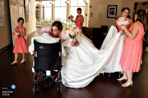 Montana Wedding Photographer | Image contains: wheelchair, color, getting ready, father, bride, flowergirl, bridesmaids