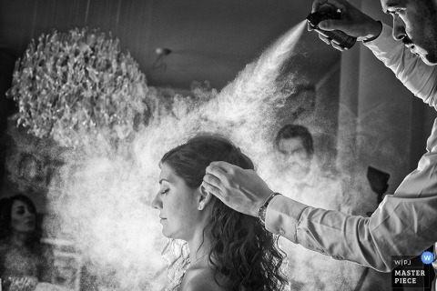Wedding Photographer in Arezzo | Image contains: hairspray, black, white, getting ready, bride, indoors