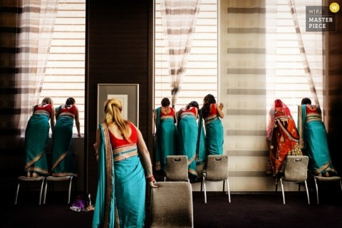 Charleston Wedding Photography | Image contains: SC bridal party in bridesmaid dresses waiting for ceremony