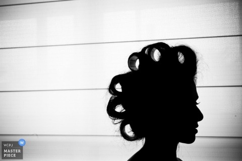 Brazil Wedding Photography | Image contains: bride, getting ready, silhouette, curlers, rollers, preceremony