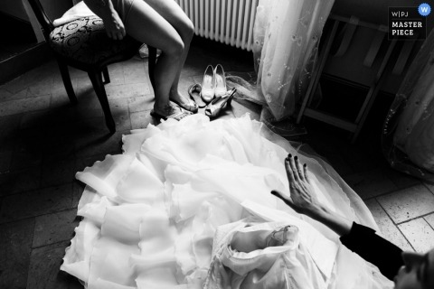 Siena Wedding Photography | Image contains: getting ready, black, white, bride, dress, indoors