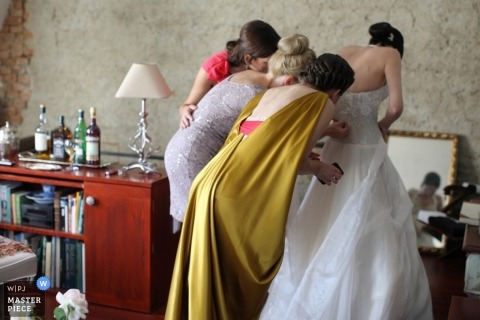 Wedding Photographer in  Slovakia | Image contains: getting ready, color, indoors, bride, dress, women, zipper