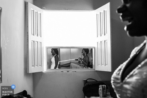 Bahia Documentary Wedding Photographer | Image contains: indoors, window, mirror, reflection, getting ready
