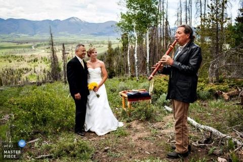 Montana Wedding Photographer | Image contains: reception, color, hill, musician, couple, outdoors