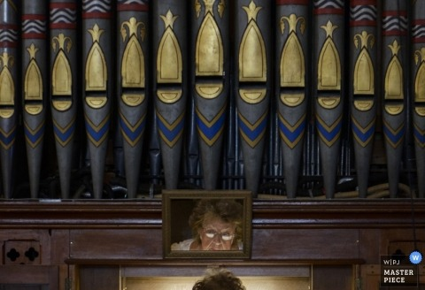 London Wedding Photographer | Image contains: pipe organ, woman, mirror, reflection, ceremony