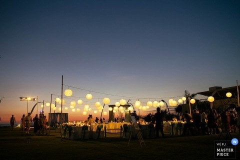 Documentary Wedding Photograph in Bali | Image contains: Indonesia outdoor sunset reception with lights