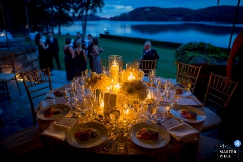 Documentary Wedding Photograph in  Queens | Image contains: outdoors, lake, color, table, sunset, blue