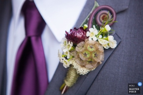 Lopez Island Wedding Photography | Image contains: detail, suit, flowers, tie, shirt, color, boutineer