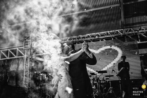Bahia Wedding Photography | Image contains: heart, smoke, groom, bride, stage, musicians, indoors