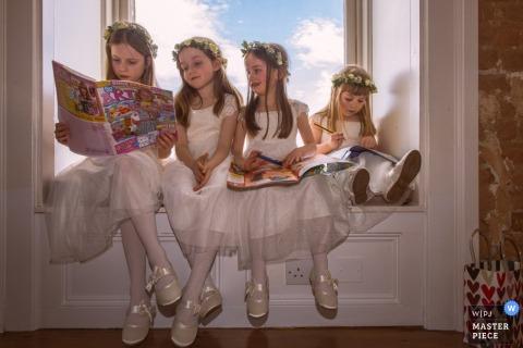 Wedding Photojournalism | Image contains: flowergirls, magazine, window seat, bag, color