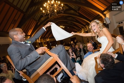 Santa Barbara Wedding Photography for CA | Image contains: bride, groom, chairs, reception, party, dance, wedding guests