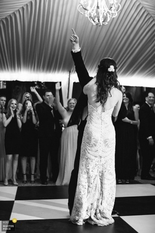 Charleston Documentary Wedding Photography | Image contains: black and white, reception, tent, bride, groom, wedding guests, dance floor, party