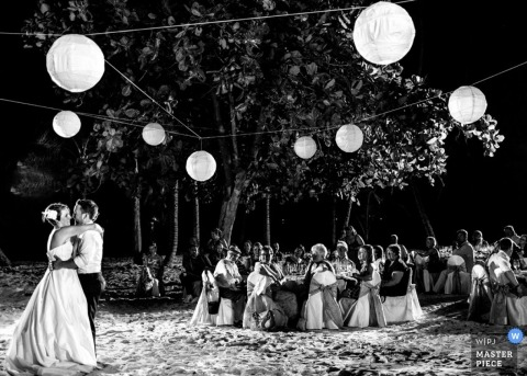 Toronto Wedding Photography | Image contains: black and white, wedding reception, wedding guests, dancing lanterns, outdoors, bride, groom