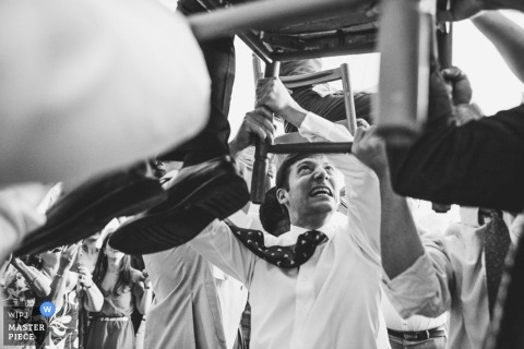 Boston Wedding Photographer | Image contains:black and white, wedding reception, groom, groomsmen, party, chair