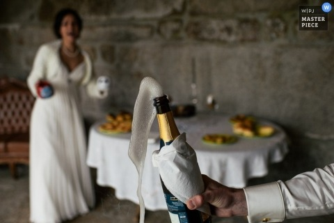 Portugal Documentary Wedding Photographer | Image contains: bride, groom, bottle, table, food, color