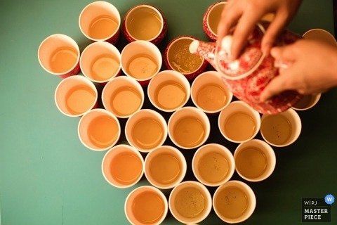 Hong Kong Documentary Wedding Photographer | Image contains: tea, cups, table, detail, orange, heart