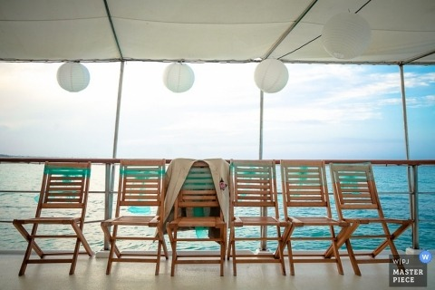Dominican Republic Documentary Wedding Photography | Image contains: ship, deck, chairs, jacket, lantern, sea, blue, detail shot