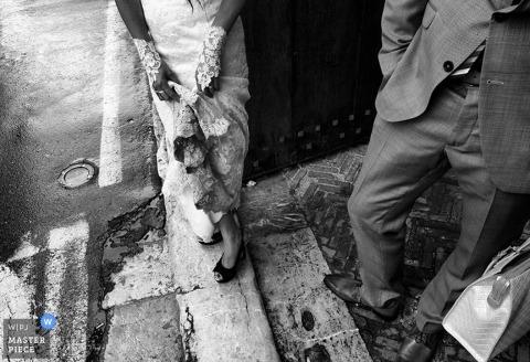 Catania Documentary Wedding Photography for Sicily | Image contains: bride, groom, door, bag, black, white, dress