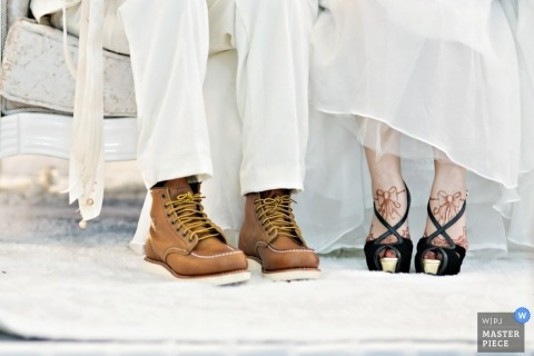 Wedding Photographer | Image contains: henna, shoes, white, dress, couch, bride, groom