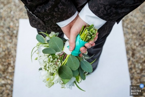 Wedding Photography in Zuid Holland | Image contains: detail, groom, hands, bride's, bouquet, ceremony