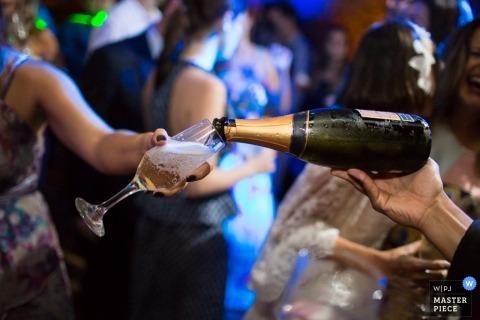 Rio de Janeiro Wedding Photographer | Image contains: champagne, glass, wedding guest, reception, indoors
