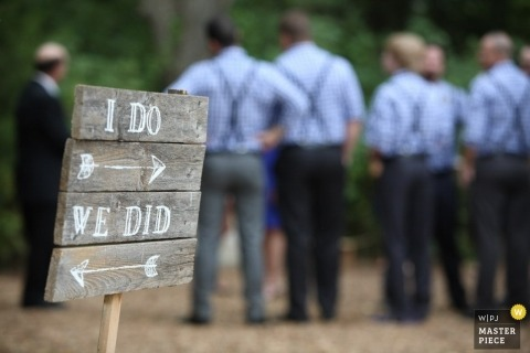 Dallas-Fort Worth Wedding Photography in TX | Image contains: sign, groomsmen, ceremony, detail, suspenders, blue