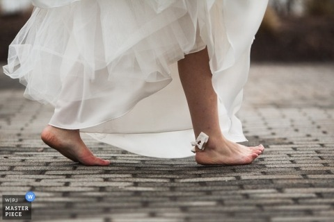 Wedding Photojournalism in Boston | Image contains: detail, dress, stone, cut, blood, feet