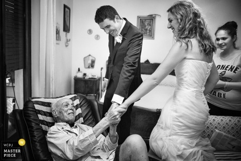 Wedding Photography in Arezzo | Image contains: father, bride, groom, bedroom, black, white, hands
