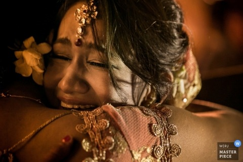 Toronto Documentary Wedding Photographer | Image contains: laughing, crying, traditions, hug, bride