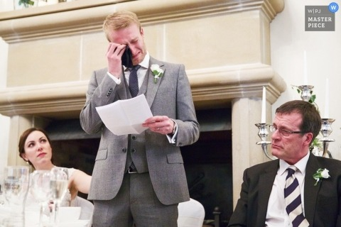 Leicestershire Documentary Wedding Photographer | Image contains: toast, speech, groom, father, bride, crying, reception