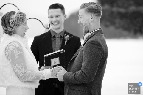 Coeur d'Alene Wedding Photojournalism | Image contains: bride, groom, ceremony, happy, outdoors, snow