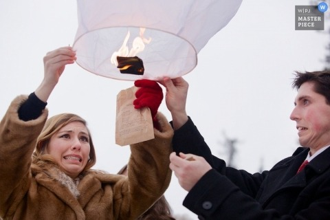 Coeur d'Alene Wedding Photojournalism | Image contains: bride, groom, lantern, winter, cold