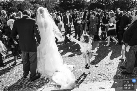 Wedding photograph from Liguria | Image contains: wedding guests, bride, flowergirl, shadows, black, white