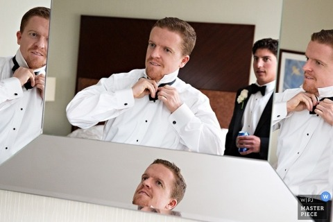 Philadelphia Documentary Wedding Photographer | Image contains: groom, geting ready, tie, mirrors, indoors,