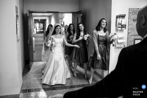 Wedding Photography in New York City | Image contains: bride, father, indoors, bridemaids, happy, flowers, hall