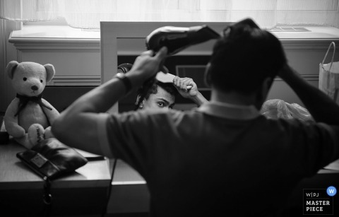 London Wedding Photojournalism | Image contains: groom, hairdryer, stuffed bear, getting ready, black, white