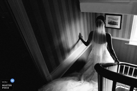 Documentary Wedding Photography | Image contains: black and white, bride, staircase, wedding dress, veil