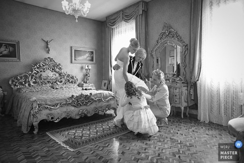 Documentary Wedding Photographer | Image contains: mother, bride, bedroom, dress, getting ready, black, white