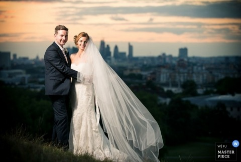 London Wedding Portrait of Bride and Groom | Image contains: bride, groom, portrait, city, outdoors, veil, wedding dress, suit