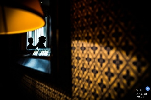 Bern Wedding Photojournalism | Image contains: pattern, hair, bride, lamp, window, color, silhouette