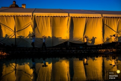Documentary Wedding Photographer in San Diego | Image contains: tent, reflection, musicians, orange, sky, outdoors