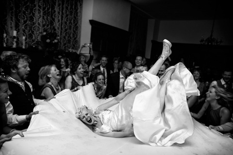 Wedding Photography in the United Kingdom in a reportage style of the bride at her reception dancing.