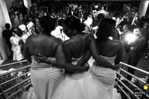 New Rochelle Artistic Wedding Photography | Image contains:black and white, bride, bridesmaids, staircase, wedding guests, portrait