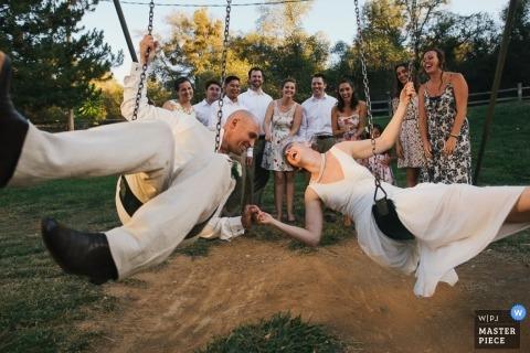 Sacramento  Wedding Photographer | Image contains: bride, groom, swings, wedding guests, portrait